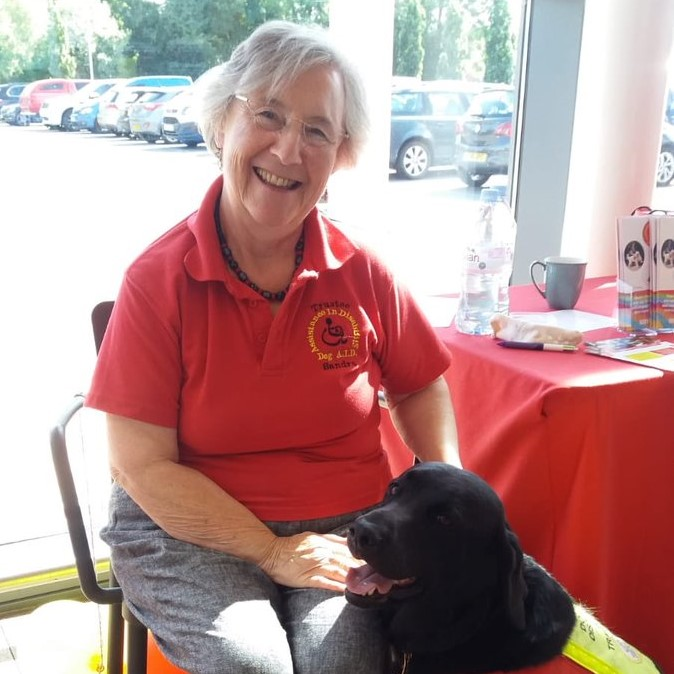 Sandra with an assistance dog