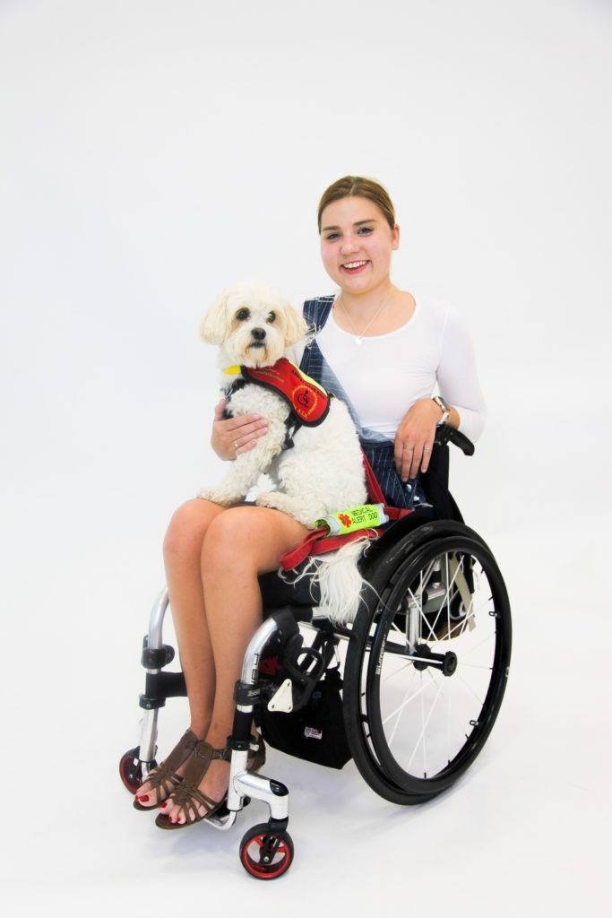 A photo of a woman with her assistance dog